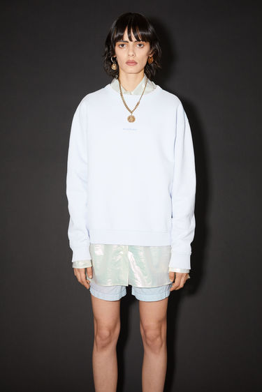 Acne Studios pale blue crew neck sweatshirt is made of cotton with an Acne Studios logo at the centre chest.