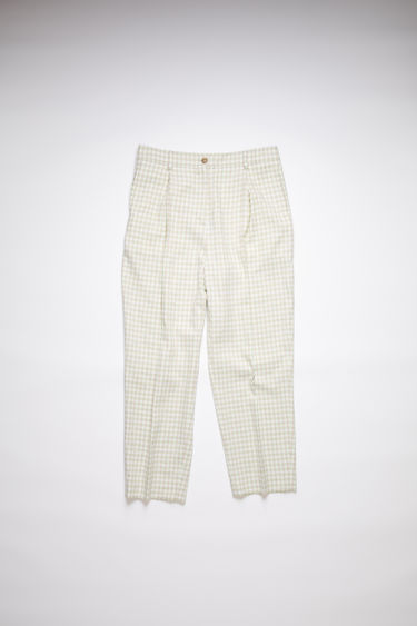 Acne Studios green/grey pleated trousers are made of a cotton blend tweed with a classic fit.