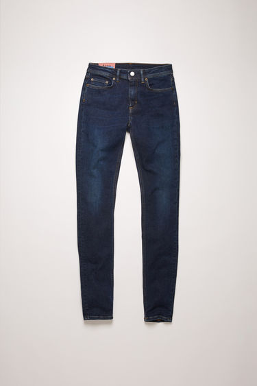 Acne Studios Climb Dark blue jeans are crafted from super stretch denim that's washed to give a worn-in appeal. They're cut to a mid-rise waist with a skinny, cropped leg and accented with subtle whiskering and fading.