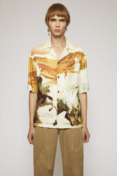 Acne Studios cream multi short-sleeved shirt is cut to boxy silhouette and features a brush stroke-style print of galloping horses.