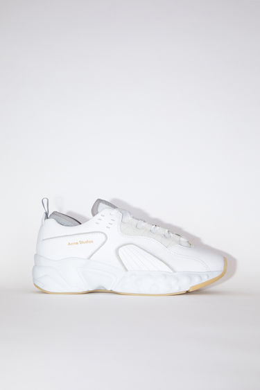 Acne Studios Rockaway Leather white sneakers takes cues from '90s American urban sportswear. They are crafted to a bulky silhouette with a lace-up front and set on a sculpted platform sole. The size runs larger, please take a size smaller than usual.