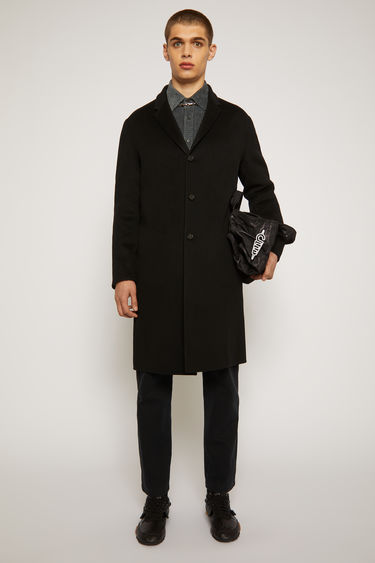 Acne Studios Chad black coat is crafted from double-faced wool to an oversized silhouette with notched lapels and side slip pockets, then finished with three button closures.
