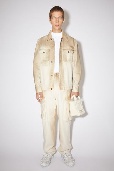 Acne Studios ecru beige casual workwear jacket is made of cotton with two button chest pockets and a bleached finish.