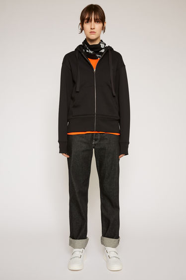 Acne Studios Ferris Zip Face black is a zip-through hooded sweatshirt made from midweight brushed jersey with kangaroo slip pockets and accented with a tonal face-embroidered patch on the chest.