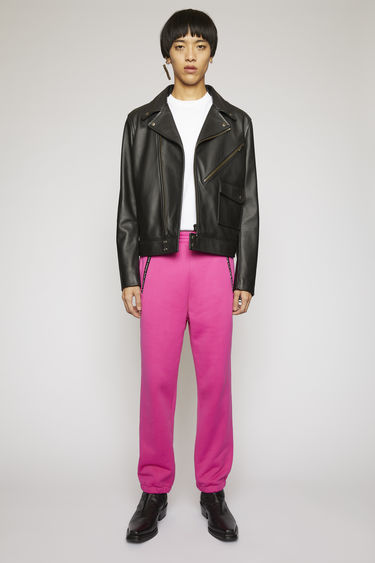 Acne Studios magenta pink sweatpants are crafted from technical loopback jersey with a subtle lustre finish and features contrasting branded zip pockets and round drawstrings.