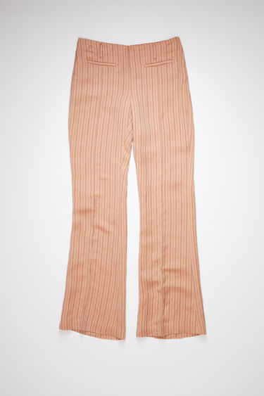 Acne Studios pink/brown suit trousers are made of a linen blend with a boot cut fit.