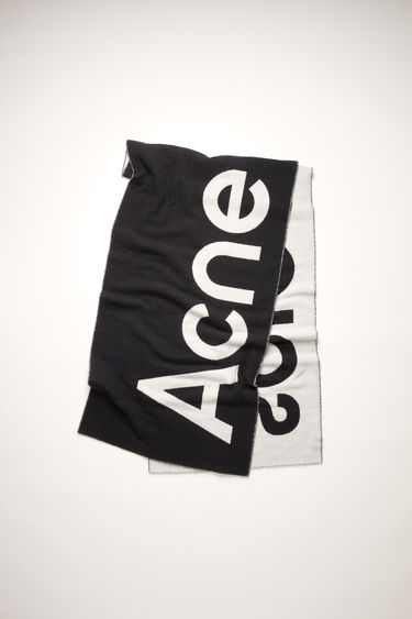 Acne Studios black/white oversized scarf is made of a soft wool blend featuring bold, contrasting logo lettering on both sides.