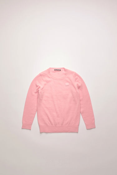 Acne Studios blush pink sweater is finely knitted from wool and neatly finished ribbed trims and a tonal face patch.