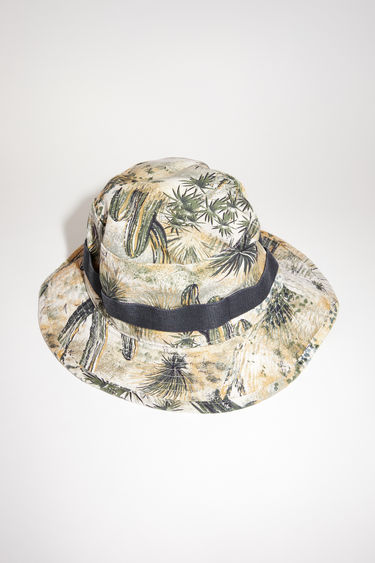 Acne Studios desert beige bucket hat is made of floral print cotton with Acne Studios logo embroidery.