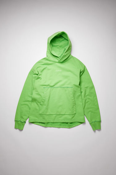 Acne Studios bright green hooded sweatshirt is crafted from organically grown cotton that's garment dyed for a soft, washed out finish. It's cut for an oversized fit that drapes loosely over the frame and features a raised logo print on front.