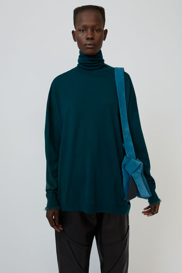 Acne Studios bottle green wool sweater is shaped to a loose silhouette with dropped shoulders and finished with alpaca-blend trims.