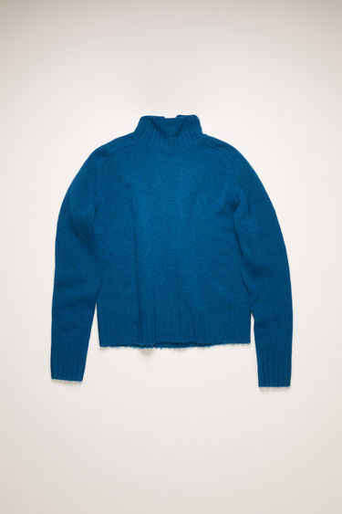 Acne Studios ocean blue high-neck sweater is knitted from Sheland wool with softly rounded shoulders, and finished with ribbed edges at the neck, cuffs, and hem.