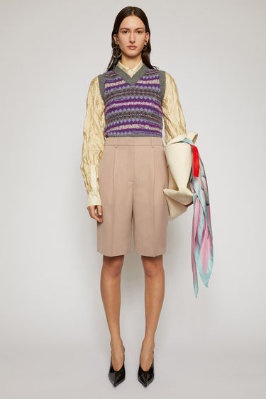Acne Studios mauve purple shorts are tailored with a high-rise waist stitched with pleats which lead loosely into straight legs.