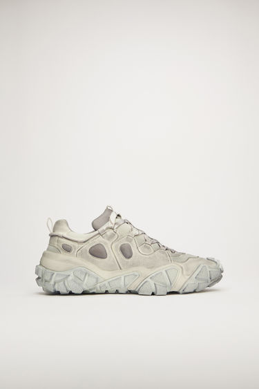 Acne Studios Bolzter Tumbled M white sneakers are crafted from mesh with faux-suede overlays and set on chunky tread soles. Every pair of sneakers are individually garment dyed to create a well-worn finish.