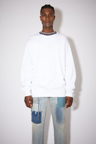 Acne Studios optic white sweatshirt is crafted from technical brushed jersey to an oversized fit with dropped sleeves and features Acne Studios logo woven along the neckline.