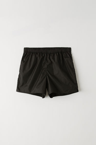 Acne Studios black elastic waist swim trunks.