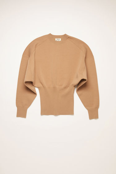 Acne Studios desert beige sweater is shaped with dolman sleeves and a wide, ribbed waist.