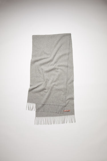 Acne Studios light grey melange narrow fringed scarf is made of pure wool, featuring a label in one corner.