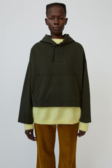 Acne Studios Joghy forest green hooded sweatshirt is shaped for an oversized fit and accented with an embossed logo.