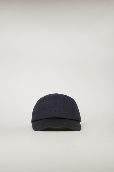 Acne Studios navy blue cap is crafted from cotton twill to a six-panel construction with a curved brim and finished with an embroidered logo on the front.