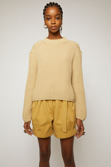 Acne Studios cold beige sweater is knitted in a full cardigan stitch and shaped to a relaxed fit with a round neck and dropped shoulders.
