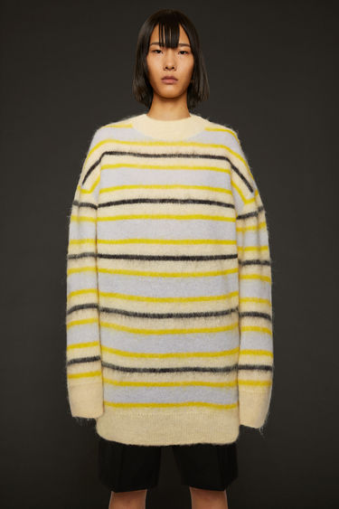 Acne Studios yellow/multi striped sweater is crafted from an alpaca blend with hints of wool to create a soft brushed finish and shaped to an oversized fit with dropped shoulder seams.