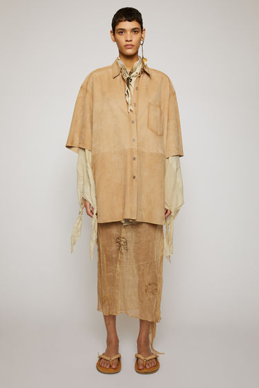 Acne Studios almond beige suede shirt is crafted to an oversized fit with a point collar and wide, short sleeves and finished with raw edges and airbrushed seams for a time-worn finish.