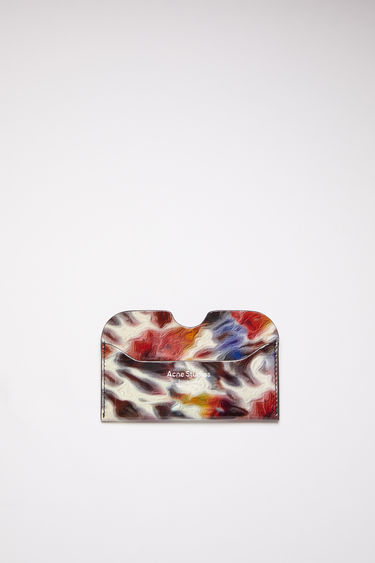 Acne Studios multicolor tie-dye printed card holder is made of calf leather with a gold logo stamp.