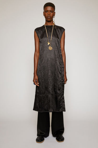 Acne Studios black sleeveless dress is crafted from satin to a relaxed fit and features an embossed floral pattern. It's shaped with a round neckline that ties at the nape.