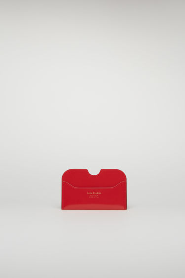 Acne Studios Elmas shiny red cardholder is crafted from high-shine leather and features three card slots with a gold logo stamp at the front.