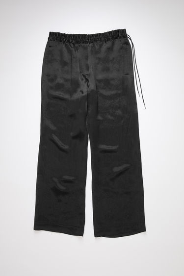 Acne Studios black casual satin trousers have a drawstring elastic waistband and relaxed fit.