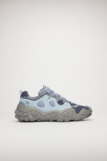 Acne Studios Bolzter M mineral blue sneakers are crafted from mesh with faux-suede overlays, and set on chunky tread soles.
