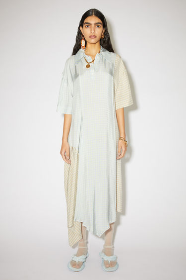 Acne Studios blue/cream asymmetric hem dress is made of viscose in two subtle check prints.