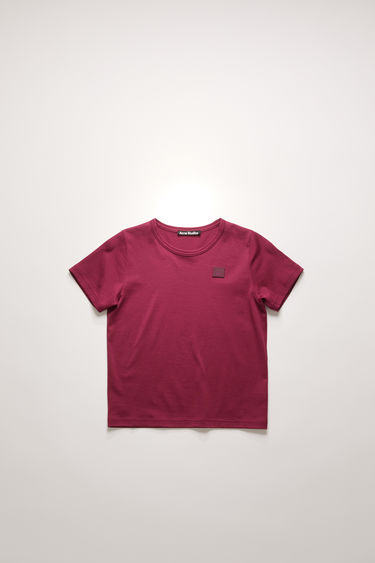 Acne Studios Mini Nash Face dark pink t-shirt is cut from a lightweight cotton jersey with a ribbed crew neck and short sleeves, then accented with a tonal face-embroidered patch on front.