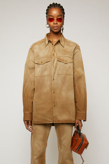Acne Studios beige overshirt is crafted from cotton twill that's washed to give a worn-in finish. It's cut for an oversized fit and features dropped shoulder seams and elongated hemline. This item is individually crafted, therefore, the colour may slightly differ from the images shown.