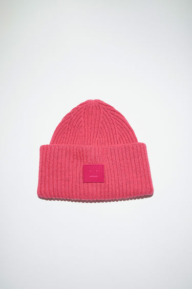 Acne Studios neon pink beanie hat is made from rib knit wool with a face logo patch.