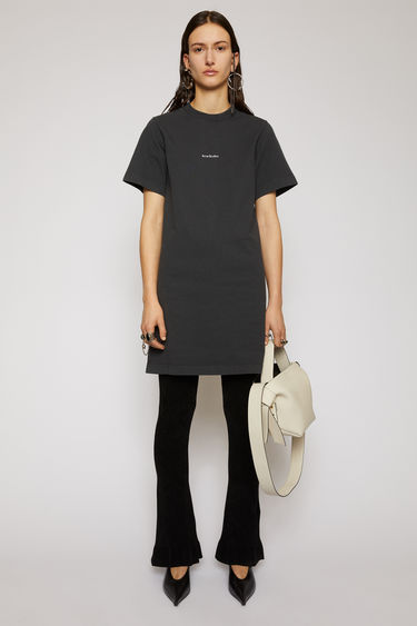 Acne Studios black dress is made from pigment-dyed jersey that's lightly faded along the seams. It's cut to a relaxed silhouette with dropped shoulders and features a raised logo print on front.