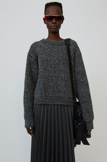 Acne Studios grey/dark grey rib-knit sweater is shaped to a boxy silhouette with dropped shoulders.