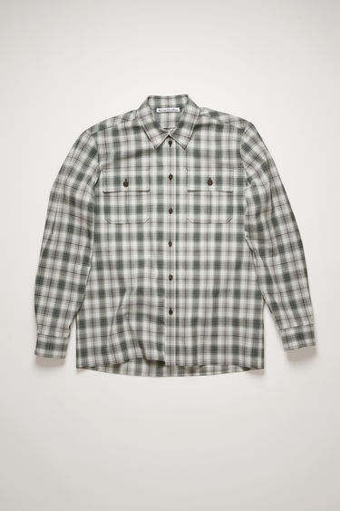 Acne Studios black/mint blue shirt is cut to a relaxed silhouette from checked cotton-flannel and has a pair of patch pockets at the chest.