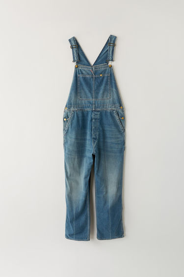 Acne Studios Blå Konst indigo denim overalls with a worn, vintage look.