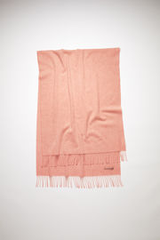 Acne Studios rose melange oversized fringed scarf is made of pure wool, featuring a label in one corner.