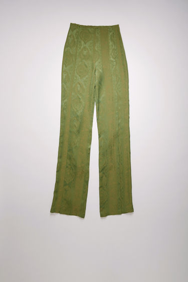 Acne Studios green/beige trousers are crafted from satin viscose that's jacquard woven with a paisley pattern and are cut to flared, slim-fitting legs with neat, stitched folds through the front.