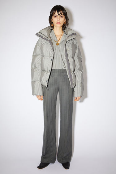 Acne Studios grey/black suit trousers are made of a linen blend with a boot cut fit.