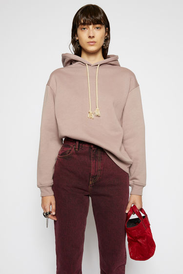 Acne Studios mauve purple hooded sweatshirt is made from organically grown cotton and shaped to a relaxed silhouette with dropped shoulders and ribbed edges.