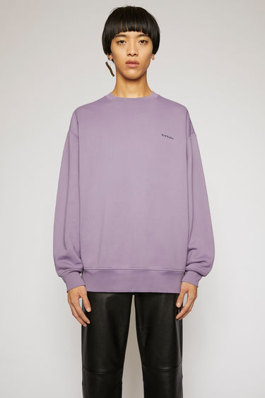 Acne Studios lilac purple sweatshirt is crafted from loopback jersey that holds a subtle lustre and it features a transparent jellyfish patch at the back.
