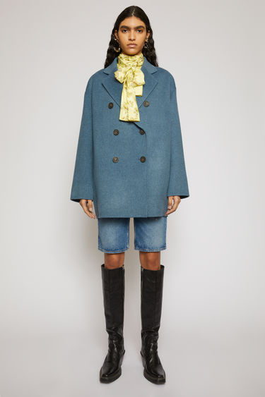 Acne Studios aqua blue melange double-breasted coat is crafted from double-faced wool to a relaxed silhouette with dropped shoulder seams and notch lapels.