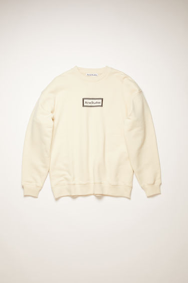 Acne Studios warm white sweatshirt is crafted for an oversized fit from midweight loopback jersey and adorned with a label patch on front.