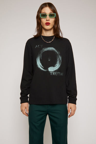 Acne Studios black sweatshirt is crafted from organically grown cotton to a relaxed silhouette and features a mandala-inspired print on the front.