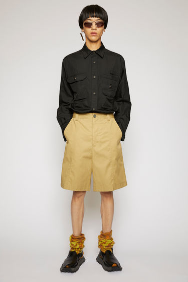 Acne Studios mushroom beige shorts are cut from a technical cotton twill with a high-rise waist and wide legs and finished with wide belt loops and patch pockets.