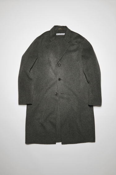 Acne Studios Chad dark grey melange coat is crafted from double-faced wool to an oversized silhouette with notched lapels and side slip pockets, then finished with three button closures.